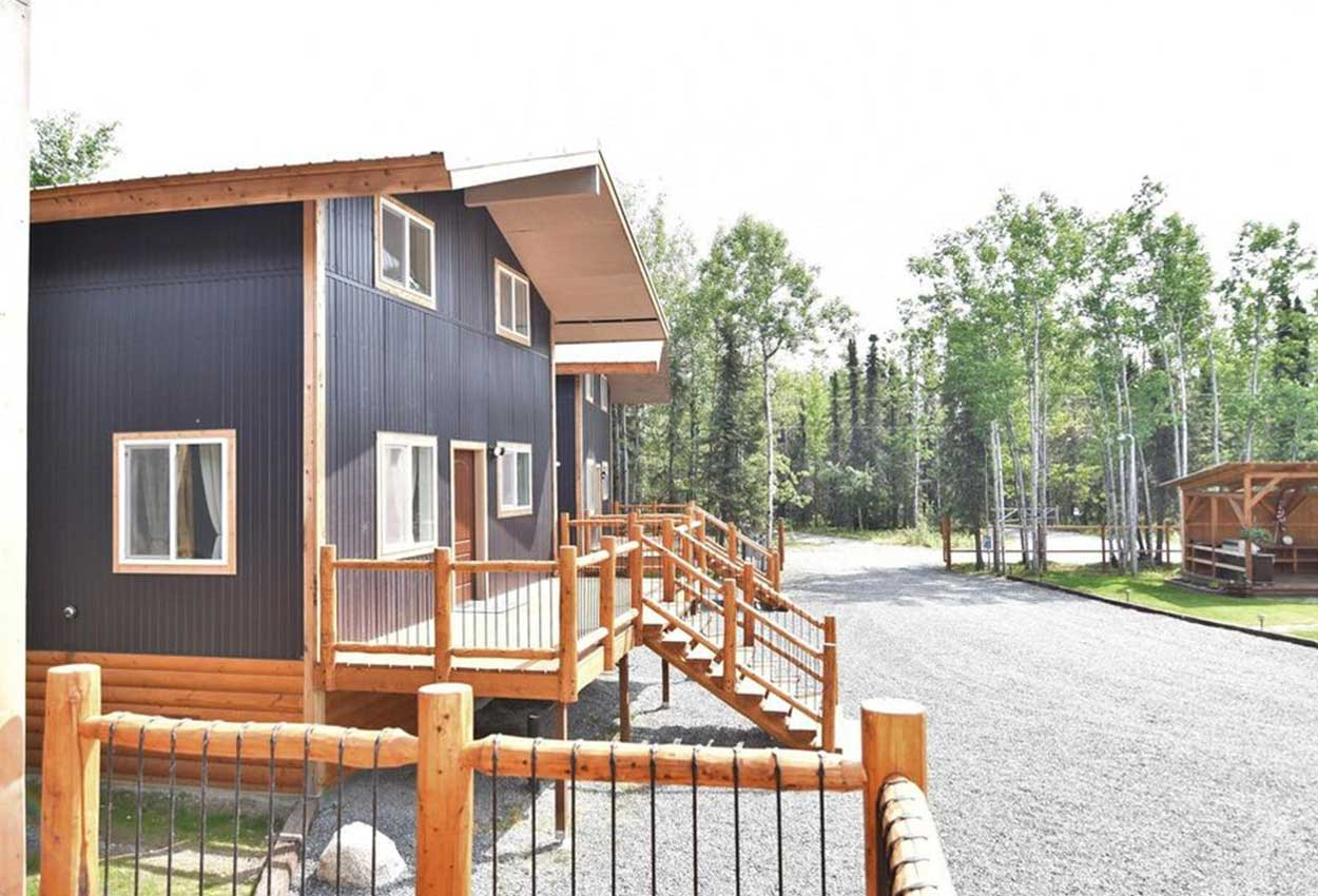Exterior area of RodFather Lodge with stairs and multiply lodges
